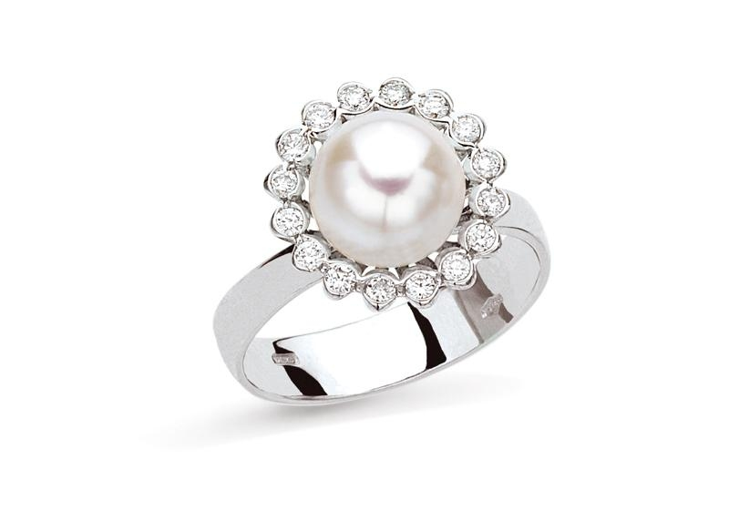 pearl ring surrounded by diamonds